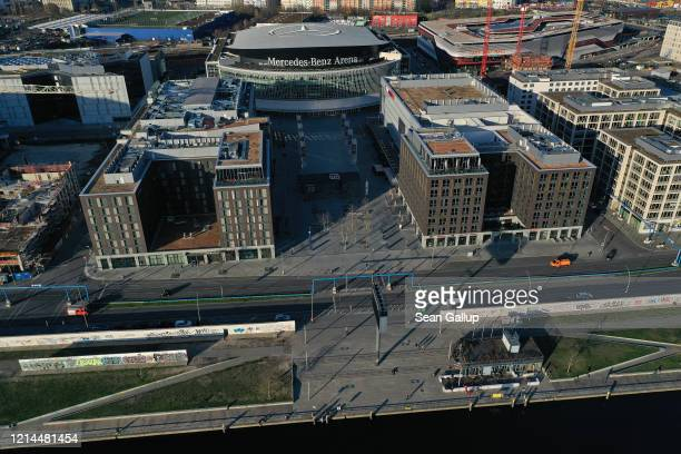In this aerial view the plaza in front of the Mercedes-Benz Arena, which under normal circumstances draws visitors to its shops and restaurants,...