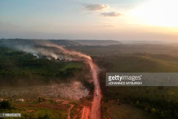 "In this aerial view the red dust of the BR230 highway, known as ""Transamazonica"", mixes with fires at sunset in the agriculture town of Ruropolis,..."