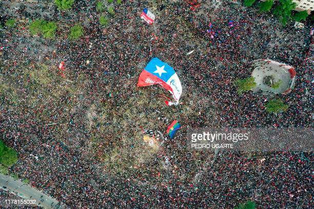 In this aerial view thousands of people protest in Santiago, on October 25 a week after violent protests started. - Demonstrations against a hike in...