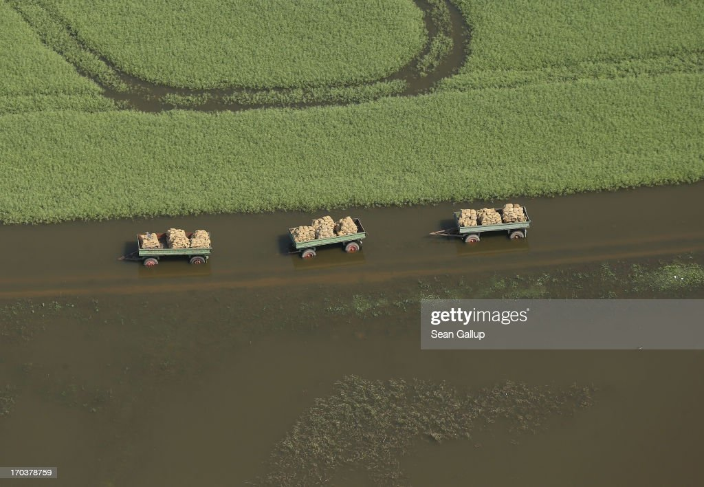 In this aerial view three farm wagons loaded with sacks stand in floodwaters from the Elbe river on June 12, 2013 near Fischbeck, Germany. The swollen Elbe is continuing to endanger communities along its northern route in Saxony-Anhalt and Brandenburg states, though the bursting of a dyke near Fischbeck has relieved some pressure from towns farther north. Floods have ravaged portions of southern and eastern Germany in the last week, leaving at least eight people dead and forcing tens of thousands to evacuate their homes.