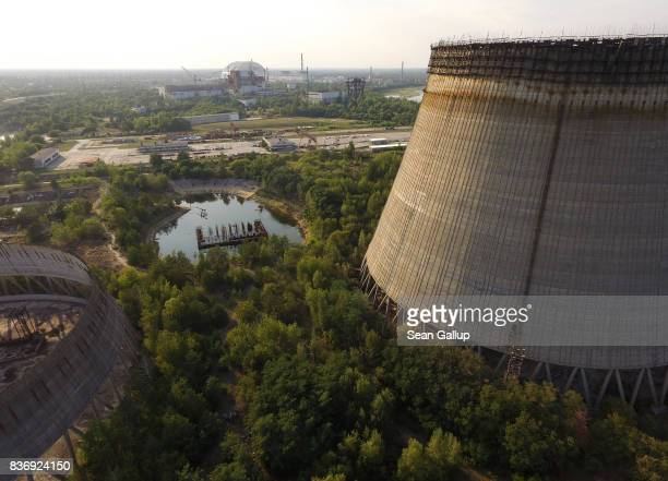 CHORNOBYL' UKRAINE AUGUST 19 In this aerial view two partiallyconstructed and abandoned cooling towers stand as the new enclosure built over stricken...