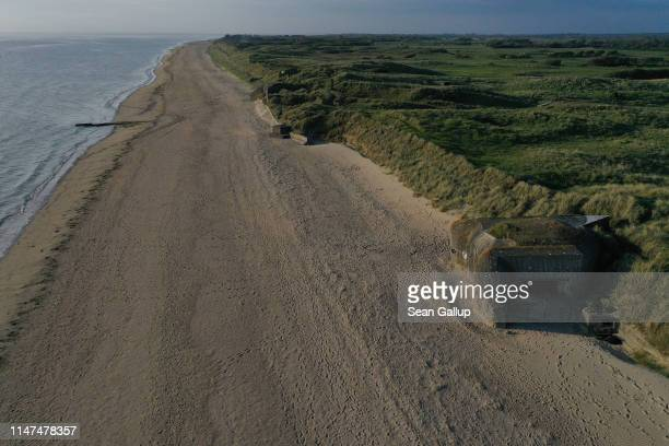 In this aerial view World War IIera German bunkers look out at Utah Beach in Normandy on May 2 2019 near SainteMarieduMont France June 6 will mark...