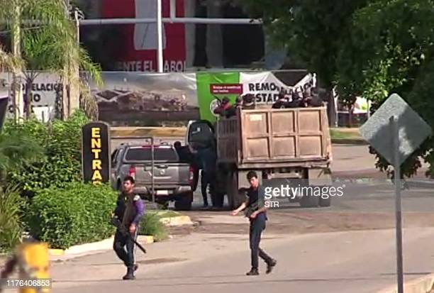 In this AFPTV screen grab armed gunmen are seen in a street of Culiacan state of Sinaloa Mexico on October 17 2019 Heavily armed gunmen in fourbyfour...
