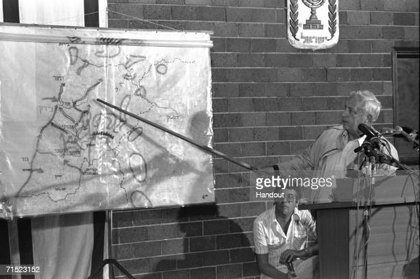 In this archive image provided by the Israeli Government Press Office , Israeli Defense Minister Ariel Sharon speaks at a press conference on the...