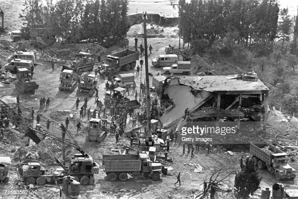 In this archive image provided by the Israeli Government Press Office Israeli soldiers search through the rubble for the bodies of comrades after an...