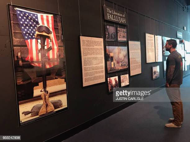 In this August 10 photograph provided to AFP Justin Carlisle is seen at the Marine Corps Museum in Triangle Virginia following a reunion with his...