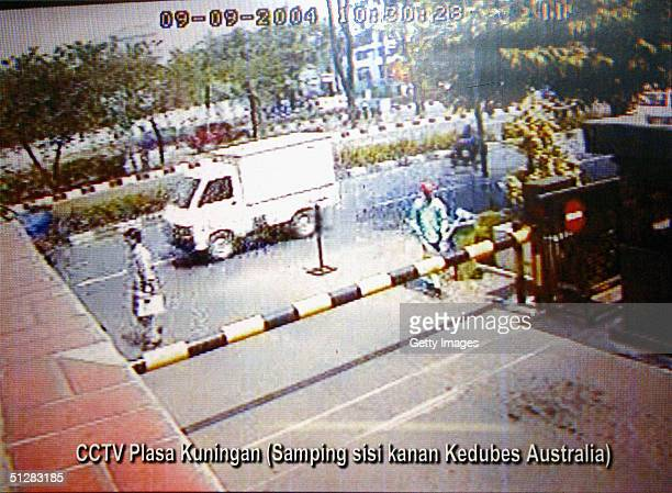 In this CCTV frame grab handed out by police in Indonesia shot from a building next to the Australian Embassy, a small truck, believed to be the...