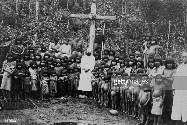 UNDATED In this collect photograph courtesy of the Jesuit General Curia in Rome Jesuits on a mission in Paraguay pose with local people The...