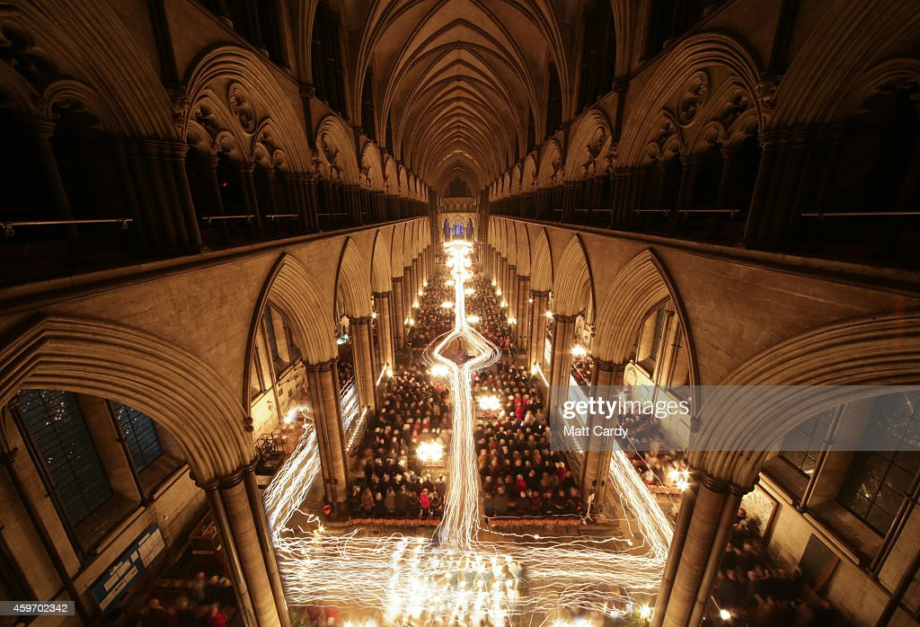 In this combination of two images the interior of Salisbury Cathedral is illuminated by trails of candles carried by choristers during the annual 'darkness to light' advent procession on November 28, 2014 in Salisbury, England. The service, which begins with the medieval cathedral in total darkness and silence before the Advent Candle is lit at the West End, is one of the most popular services of the liturgical year. The annual advent service, which also takes place over tonight and tomorrow night and is seen by several thousand people, is a mix of music and readings during which two great candlelit processions move around the different spaces in the 12th-century building which, by the end, is illuminated by almost 1300 candles and is a spectacular start to the Christmas season.