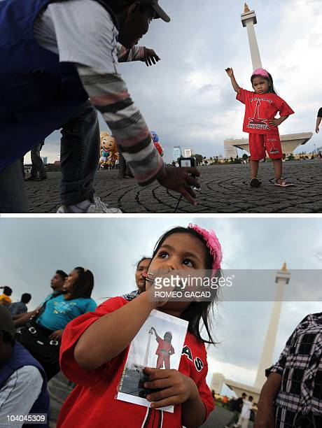 In this combo photograph Novita a four year old Indonesian girl is directed how to pose by a local park photographer at Jakarta's popular landmark...