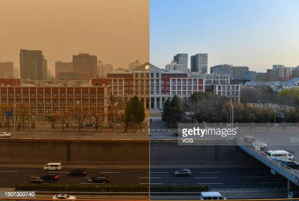 In this composite image a comparison, a building is pictured in sandstorm on March 15, and under clear sky on March 16, 2021 in Beijing, China.