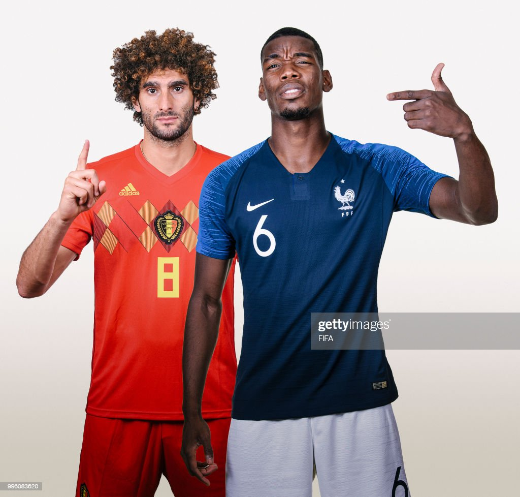 IMAGES - Image numbers 974391780,971572496) In this composite image a comparison has been made between Marouane Fellaini of Belgium and Paul Pogba of France. Belgium and France meet in one of the FIFA World Cup 2018 semi finals.