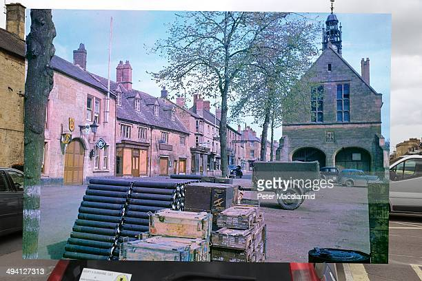 In this composite image a comparison has been made of Moreton in Marsh England DDay took place on June 6 1944 Image A vew of a town square stockpiled...