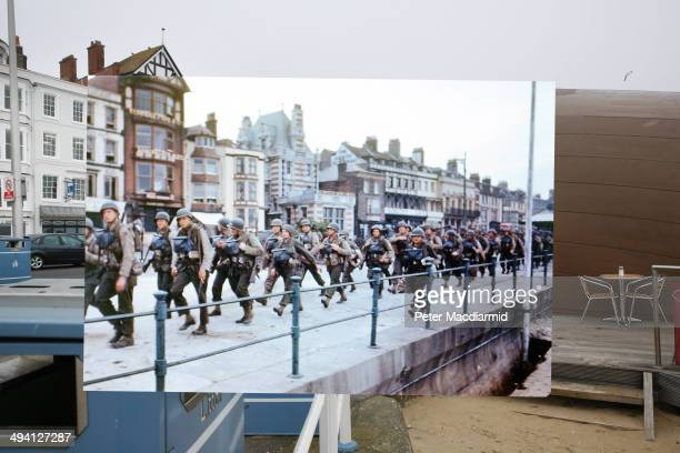 In this composite image a comparison has been made of Weymouth England DDay took place on June 6 1944 Image US troops on the Esplanade at Weymouth...