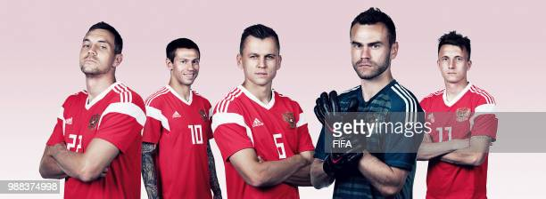 In this composite image Artem Dzyuba Fedor SmolovDenis Cheryshev Igor AkinfeevAleksandr Golovin of Russia pose for a portrait during the official...