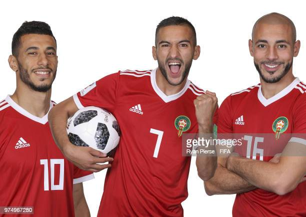 In this composite image Aziz Bouhaddouz Hakim Ziyech and Youssef Ait Bennasser of Morocco pose during the official FIFA World Cup 2018 portrait...