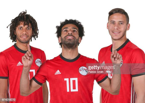 In this composite image Mohamed Elneny Mohamed Salah and Ramadan Sobhi of Egypt pose for a portrait during the official FIFA World Cup 2018 portrait...