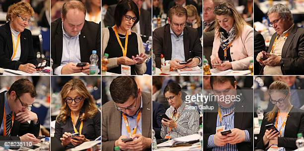 In this composite image of 12 separate photographs delegates of the German Christian Democrats read or type on their smartphones during debates at...