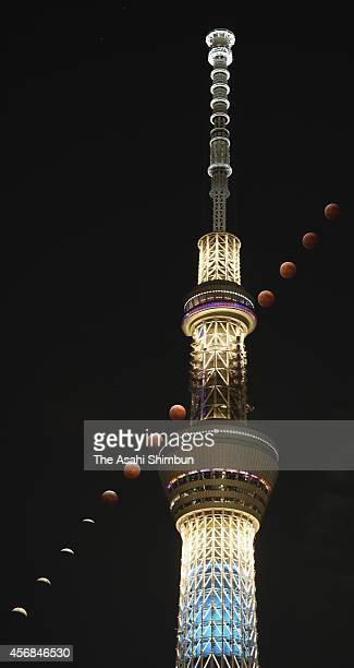 In this composite image of images shot in 5min interval from 700pm to 810pm local time the moon is seen passing the Tokyo Sky Tree during a total...