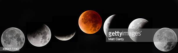 In this composite image of seven different photographs the moon is seen as it enters and leaves a lunar eclipse on September 28 2015 in Glastonbury...
