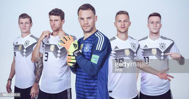 In this composite image Toni KroosThomas MuellerManuel Neuer Joshua KimmichMarco Reus of Germany pose for a photo during the official FIFA World Cup...