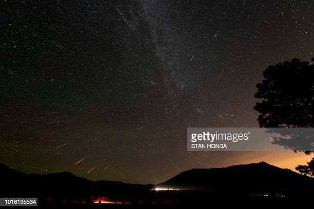 In this composite photograph 15 Perseid meteors are seen over Rocky Mountain National Park in Colorado in the early morning hours of August 13 2018...