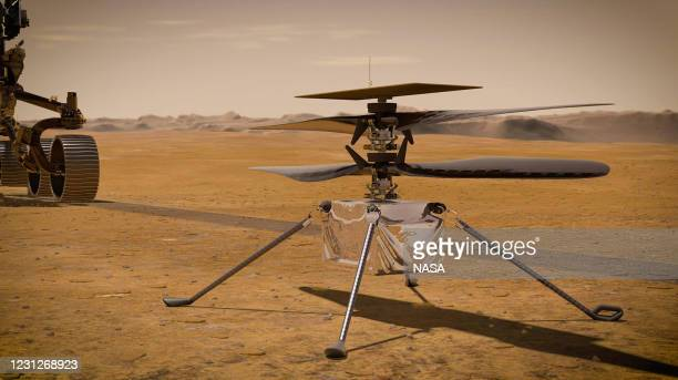 In this concept illustration provided by NASA, NASA's Ingenuity Mars Helicopter stands on the Red Planet's surface as NASA's Mars 2020 Perseverance...