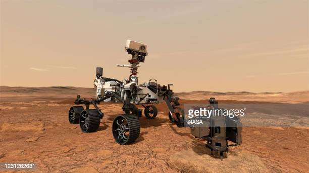 In this concept illustration provided by NASA, NASA's Perseverance rover uses its drill to core a rock sample and will store them in sealed tubes on...