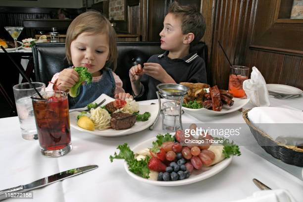 In this December 3 2004 file photograph Stella Anderson left and Christopher David both of Chicago sample items on the kids' menu at Pete Miller's...