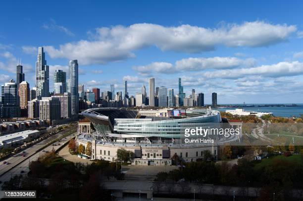 In this drone image, a general view of Soldier Field with the Chicago skyline before a game between the New Orleans Saints and the Chicago Bears on...
