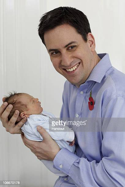 In this family handout photo Labour Leader Ed Miliband poses with his second child Samuel on November 10 2010 in London England The 8lb 3oz boy named...