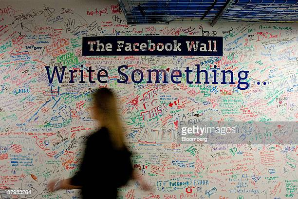 In this file photo a wall that has been written on by employees stands in the entry way at Facebook Inc's office in New York US on Tuesday Dec 20...