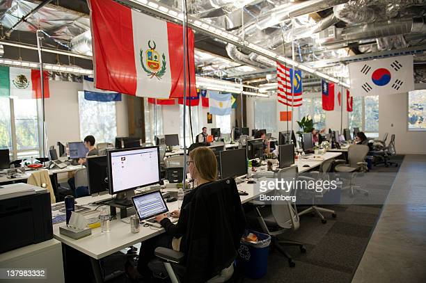 In this file photo Facebook Inc employees work at the company's new campus in Menlo Park California US on Friday Dec 2 2011 A Facebook IPO would...