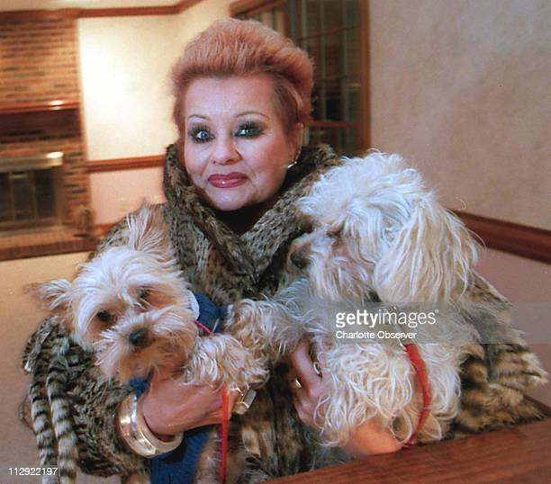 In this file photo from 1999 Tammy Faye Messner poses for a photo with her pets Messner former wife of television evangelist Jim Bakker died after a...