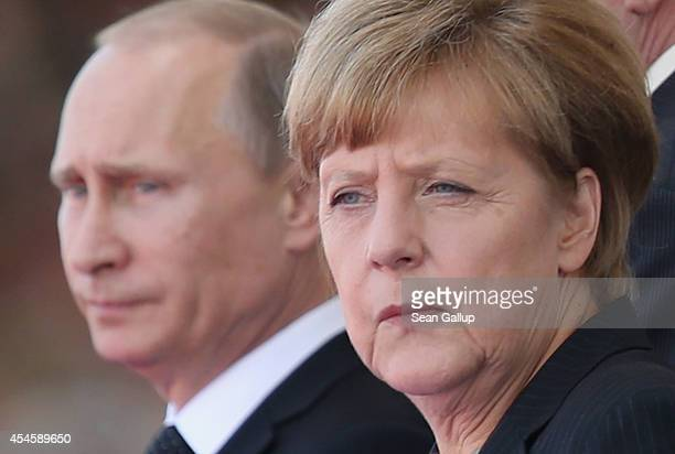 In this file photo German Chancellor Angela Merkel and Russian President Vladimir Putin attend commeoration ceremonies marking the 70th anniversary...