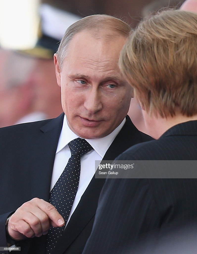 In this file photo German Chancellor Angela Merkel and Russian President Vladimir Putin attend commeoration ceremonies marking the 70th anniversary of the D-day invasion of Nazi-occupied Normandy on June 6, 2014 in Ouistreham, France. Merkel and other leaders of NATO-member states are attending a NATO summit in Newport, Wales, from September 4-5, 2014, and Russia's active involvement in the war in eastern Ukraine is high on the summit agenda.