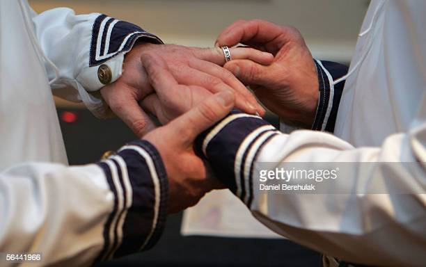 In this file photo issued on December 16 Tony Mason puts a ring on Asa Cairns' finger during a mock civil partnership ceremony at the Gay Wedding...