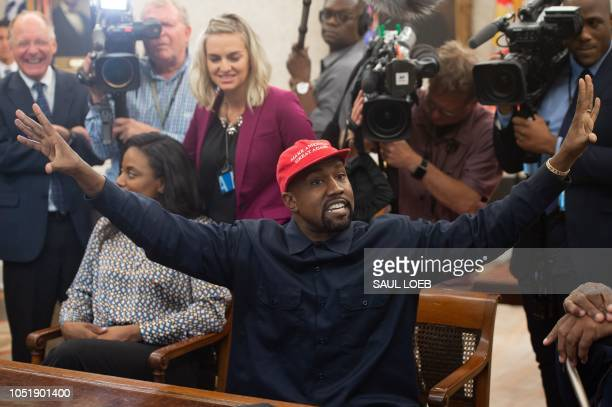 In this file photo Kanye West meets with US President Donald Trump in the Oval Office of the White House in Washington, DC, October 11, 2018. - Kanye...