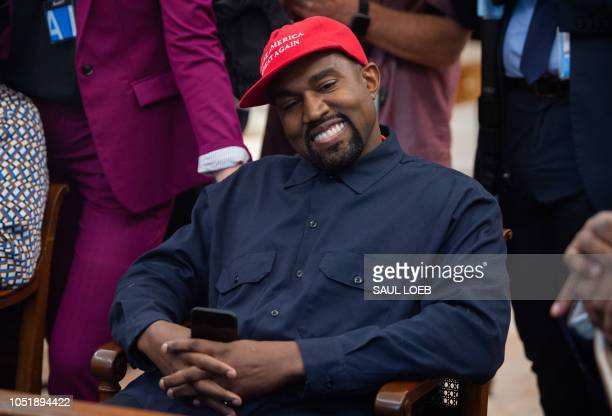 in this file photo rapper Kanye West speaks during his meeting with US President Donald Trump in the Oval Office of the White House in Washington DC...