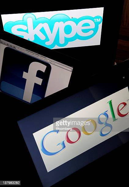 In this file photo Skype Technologies SA Facebook Inc and Google Inc logos are displayed on computer screens for a photograph in New York US on...