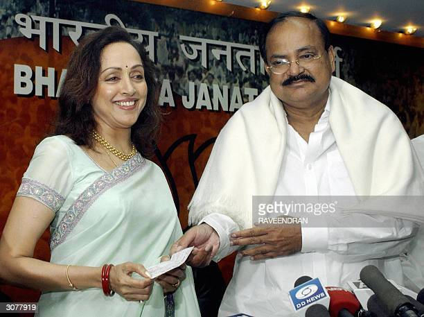 In this file photo taken 19 February 2004 Indian actress Hema Malini receives a party membership card after joining India's ruling Bharatiya Janata...