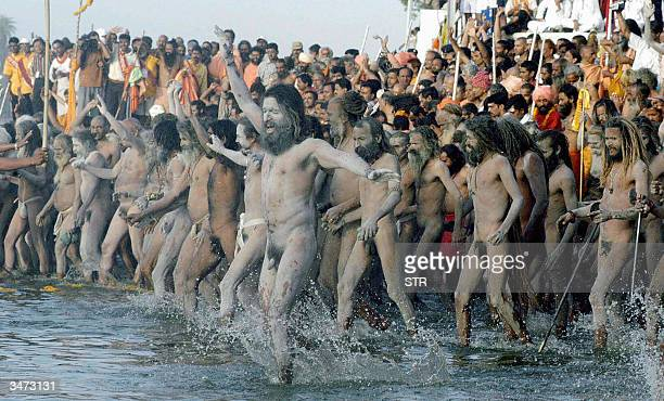 In this file photo taken 22 April 2004 Indian holymen known as Naga Sadhu's who have renounced the wearing of clothes take part in ritual bathing in...