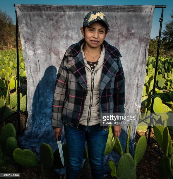 In this file photo taken on April 11 Karina Saldana poses for a photograph after harvesting nopal or prickly pear on the family farm in the Mexico...