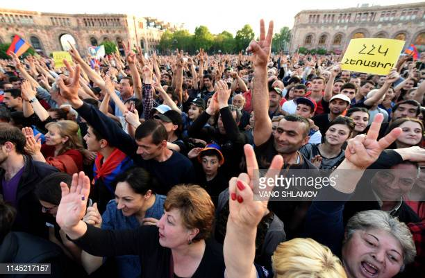 In this file photo taken on April 26 2018 shows supporters of Armenia's popular opposition leader attending a rally in downtown Yerevan What we...