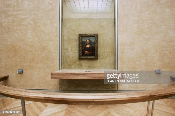 In this file photo taken on April 5 the famous painting by Italian artist Leonardo da Vinci the Joconde Mona Lisa is on display in the Salle des...