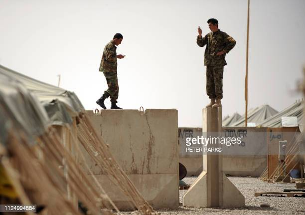 In this file photo taken on April 6 2011 shows Afghan National Army soldiers from the 2nd Brigade 215th Corps standing on top of a blast wall trying...