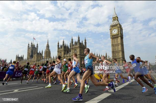 In this file photo taken on August 12, 2012 Athletes run in front of Big Ben and the Palace of Westminster during the men's marathon at the London...