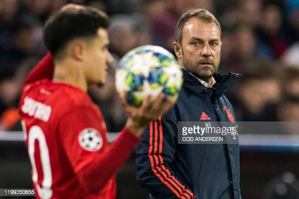 In this file photo taken on December 11 2019 Bayern Munich's German interim head coach HansDieter Flick watches Bayern Munich's Brazilian midfielder...