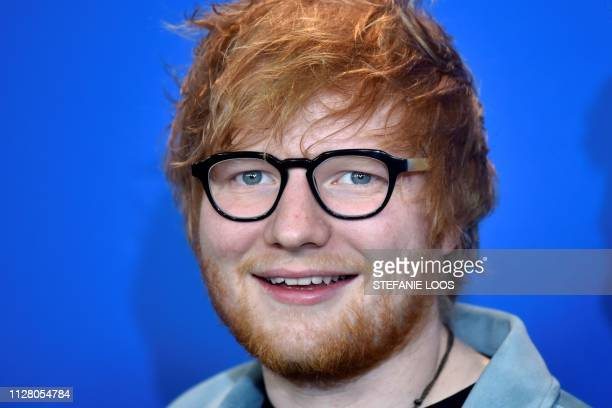 In this file photo taken on February 23 2018 British singersongwriter Ed Sheeran poses during a photocall for the film Songwriter presented in the...