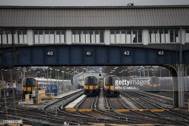In this file photo taken on January 19 2012 trains are seen at Clapham Junction train station in south London Britain unveiled on September 21 2020 a...